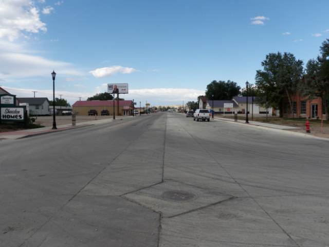 North Main Street in Sheridan after reconstruction activities. Project addressed drainage issues, installed a new storm drain outlet, upsized the sanitary sewer main, and resurfaced the road which had last been done in 1967.