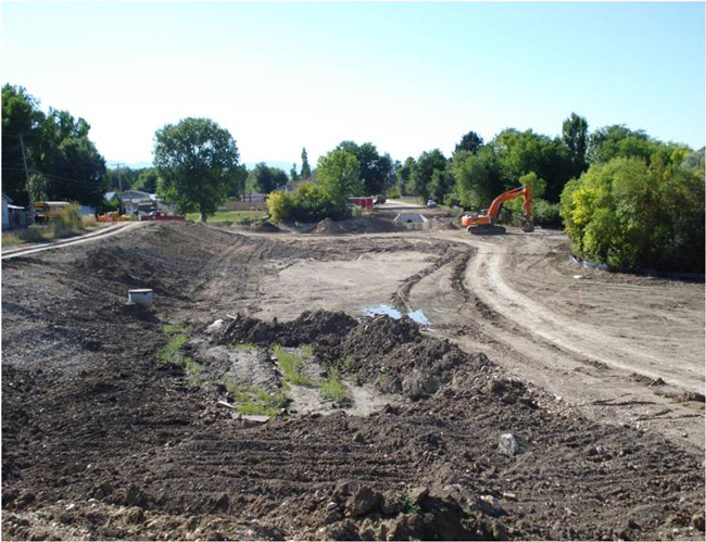 The Huntington Neighborhood storm water detention pond under construction. Today, the detention pond also serves as a dog park.
