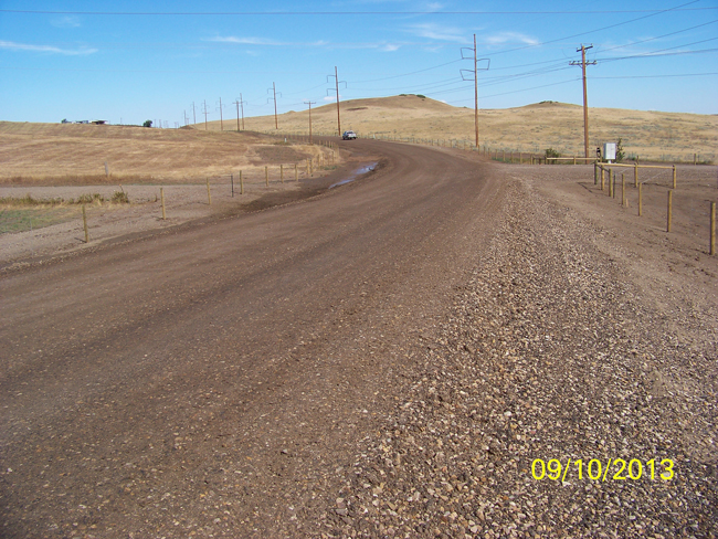 East Ridge Road after reconstruction activities. The road underwent complete reconstruction, blending gravel and culvert improvement.
