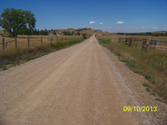 McCormick Road after reconstruction. Project upgraded this to an all-weather road, improved culverts, graded and graveled the road.