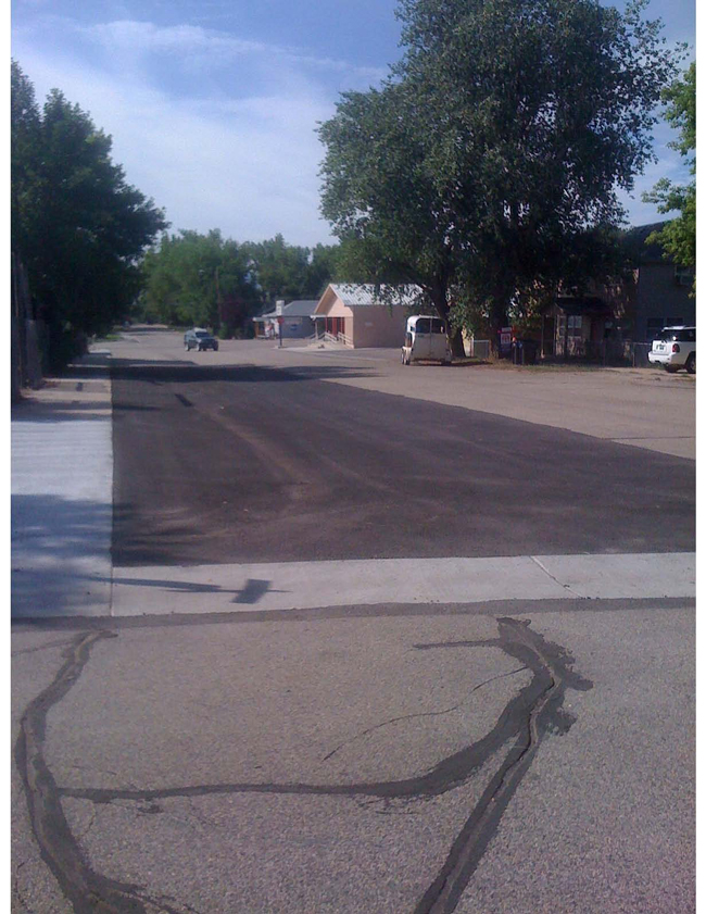 Example of chip sealing that was done to all 3 miles of Ranchester's older streets throughout the town. This project extended the lifetime of these streets by up to 10 years.